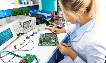 electronic engineer testing computer motherboard
