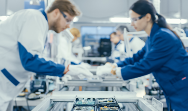 Electronics Factory Workers Assembling Circuit Boards