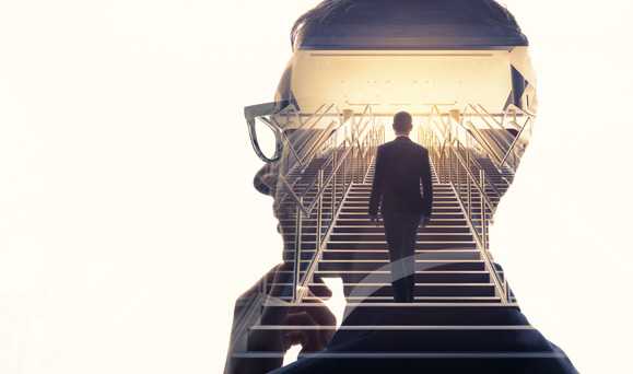 Man walking up stairs inside the silhouette of a man thinking
