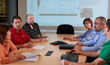 Cirtronics team reviewing FactoryLogix reports