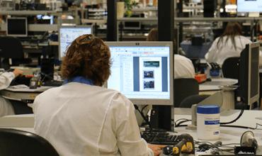 TBP Electronics worker using FactoryLogix