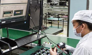 Norautron worker in factory