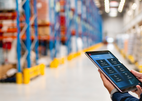 man in warehouse with ipad